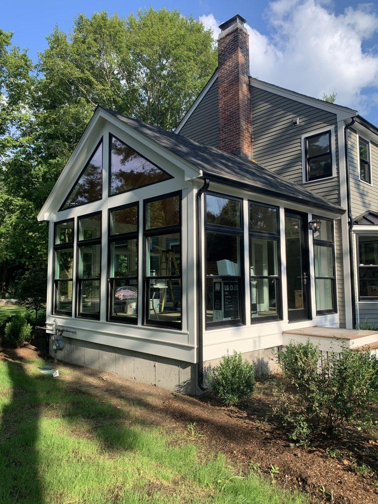Contemporary Sunroom in Weston MA by Jensen Hus Design Build
