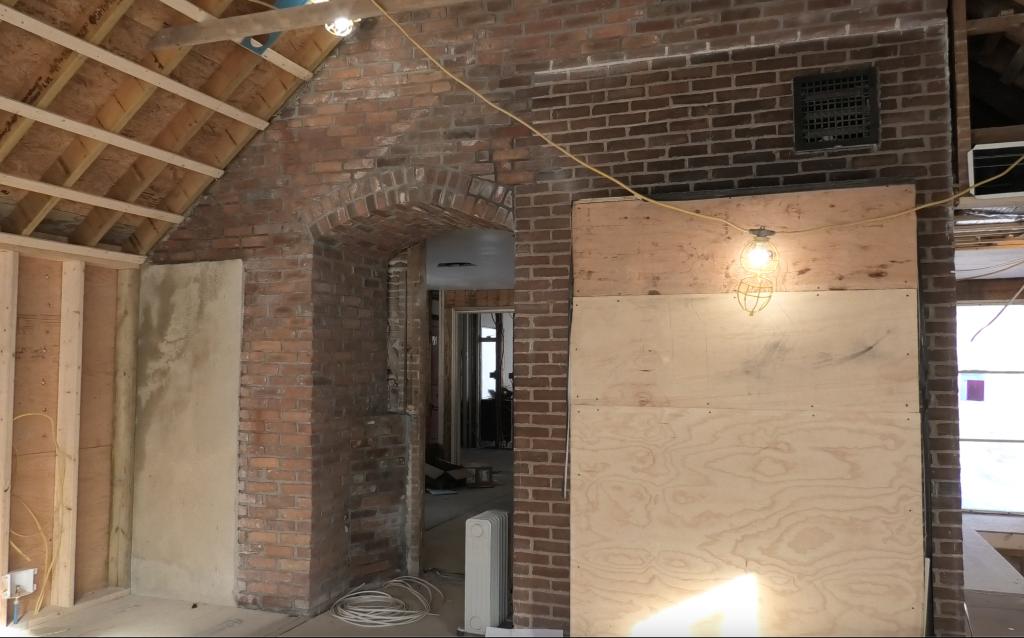 Jensen Hus contemporary kitchen design with some exposed brickwork